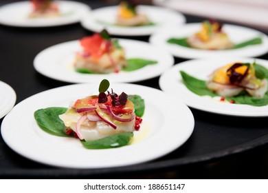 Sea scallop carpaccio dishes on tray