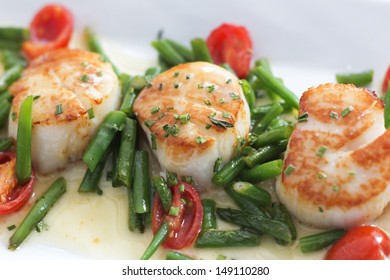 Sea Scallops with celery roots puree, haricot vert, grape tomato and chive beurre blanc.