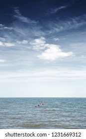 sea scape image looking out to sea from england at red buoy bobbing up and down