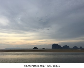 Sea scape with mountain. Sunset. Thailand sea. Island beach.