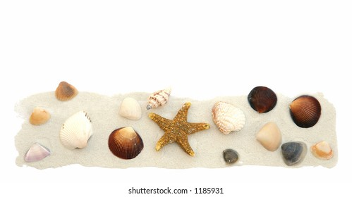 Sea shells and sand isolated on white.
