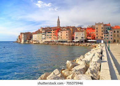 Sea shore along stone pier leading to the Venetian town of Rovinj, Croatia