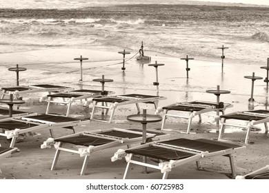 Sea shore or beach with deckchairs