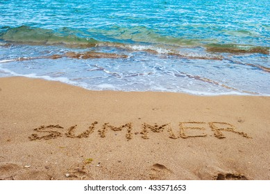 Sea shore and beach with yellow sand with word summer