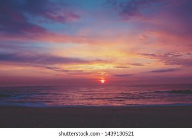 Sea shore landscape at sunset. Beautiful beach in evening.  Porto, Portugal, Europe
