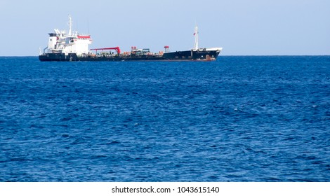 Sea shore panorama with a ship on foreground