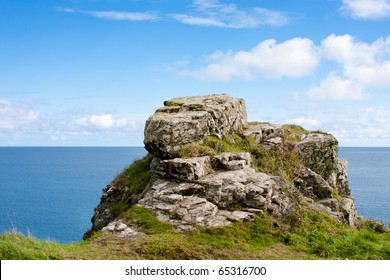 Sea Shore Rugged Rock Landscape with Vibrant Blue Sky