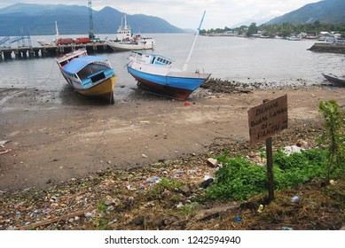 """Sea shore scenary in Alor strait , with the sign """" dont litter in here"""""""