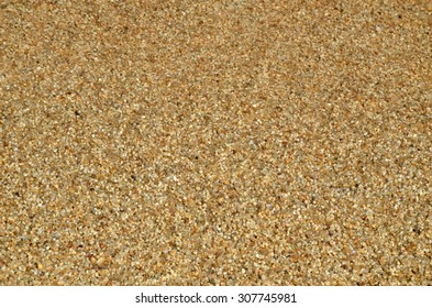 Sea shore of small pebbles with sea water as background