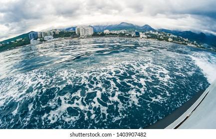 Sea shore of Yalta in the Crimea from the boat, sea voyage