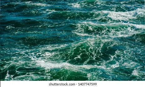 Sea shot taken from a boat - Shutterstock ID 1407747599