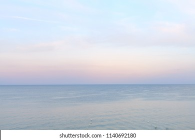 Sea side in sunset soft lighting. Soft horizon line before after sunset. Black sea beach