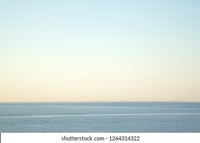 Sea and Sky Horizon with Distant City