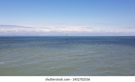 the sea and the sky, in Minehead, UK. calm and gentle sea with view stretching to the horizon and clear blue sky.