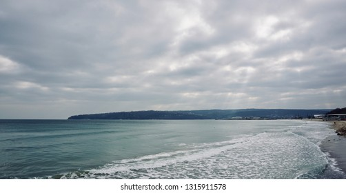 The sea and sky on a cloudy day. Gloomy nature landscape.
