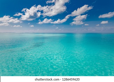 Sea and sky. Perfect blue sea water and blue sky with white fluffy clouds, tropical beach seascape and sea view. Horizontal background of blue sea. Panoramic view