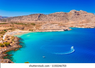 Sea skyview landscape photo of Agia Agathi beach near Feraklos castle on Rhodes island, Dodecanese, Greece. Panorama with sand beach and clear blue water. Famous tourist destination in South Europe