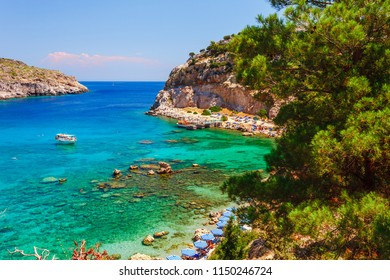 Sea skyview landscape photo Anthony Quinn bay near Ladiko bay on Rhodes island, Dodecanese, Greece. Panorama with nice sand beach and clear blue water. Famous tourist destination in South Europe