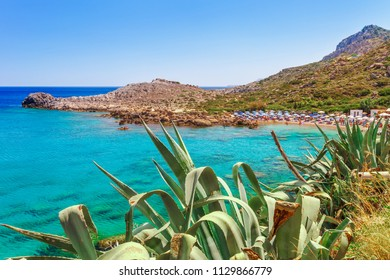 Sea skyview landscape photo Ladiko bay near Anthony Quinn bay on Rhodes island, Dodecanese, Greece. Panorama with nice sand beach and clear blue water. Famous tourist destination in South Europe
