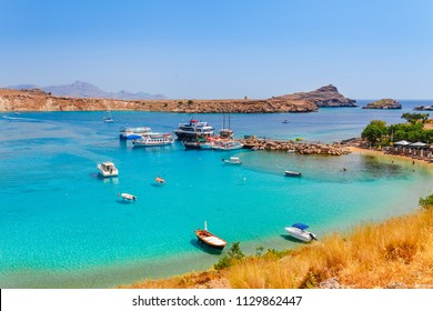 Sea skyview landscape photo Lindos bay and sea coast on Rhodes island, Dodecanese, Greece. Panorama with nice sand beach and clear blue water. Famous tourist destination in South Europe