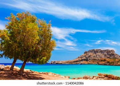 Sea skyview landscape photo near Agia Agathi beach and Feraklos castle on Rhodes island, Dodecanese, Greece. Panorama with sand beach and clear blue water. Famous tourist destination in South Europe