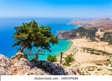 Sea skyview landscape photo Tsambika bay on Rhodes island, Dodecanese, Greece. Panorama with nice sand beach and clear blue water. Famous tourist destination in South Europe