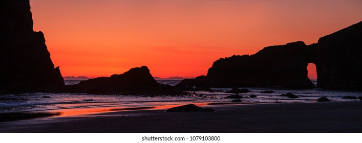 Sea stacks and beach rocks silhouetted at sunset at Second Beach on the Olympic coast of Washington state