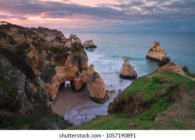 Sea stacks beach at sunrise in the town of Alvor, Portugal