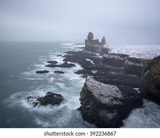 Sea stacks at Londrangar cliffs in winter, Iceland