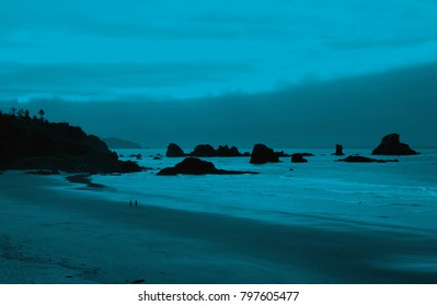 Sea stacks and misty mountains with weather front moving onshore near Cannon Beach,   Oregon Coast