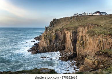 Sea and steep rugged cliffs at Lands End in Cornwall