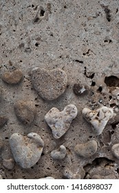Sea Stone Hearts. Beach pebble heart shaped stone collection photograped on tectural stone.