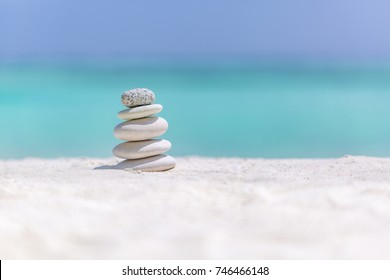 Sea stones balance and wellness retro spa concept, inspiration, zen like and well being tranquil composition. Close-up of zen stones at the beach