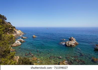 Sea stones beach. Stones on the coast of Spain