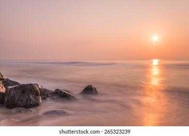 Sea stones during sunrise at Pranburi,Thailand.