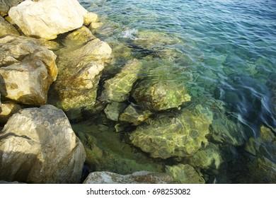 Sea stones and rocks. Mediterranean Sea