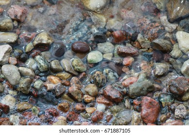 Sea stones in water background