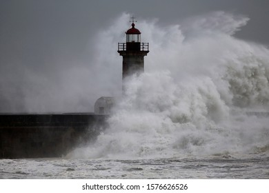 Sea storm at the Douro river mouth old lighthouse.