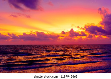 Sea and Sunset with clouds.