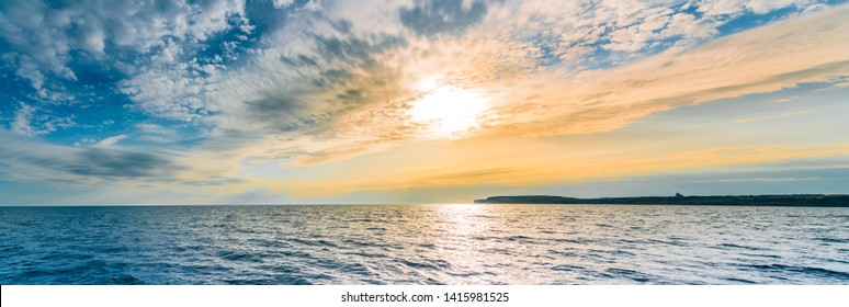 Sea sunset with colorful cloud.Panoramic view of Comino   from Malta
