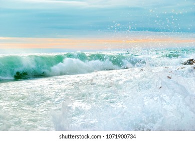 Sea sunset landscape with big waves crushing the shore