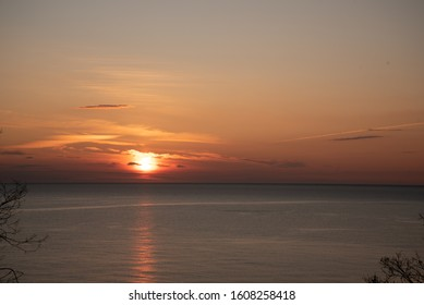 Sea sunset, sea and sky are painted with warm orange shades.