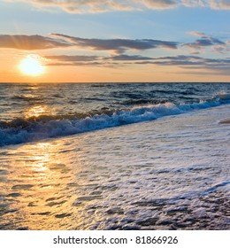 Sea  sunset surf great wave break on sandy coastline