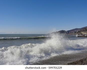 Sea surf, splashing waves on the coast