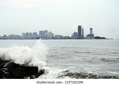 Sea surf wave with view on Batumi city, Georgia on background
