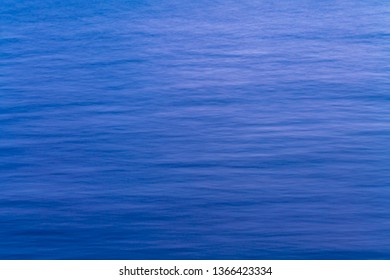 Sea surface aerial view with blue ocean waves