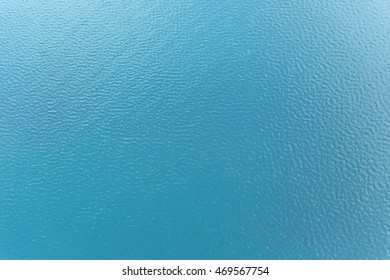 Sea surface background with waves and reflection of sunlight from above
