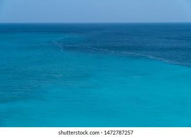 Sea surface. Blue background. Azure sea. Azure backgrond. Marine waves.