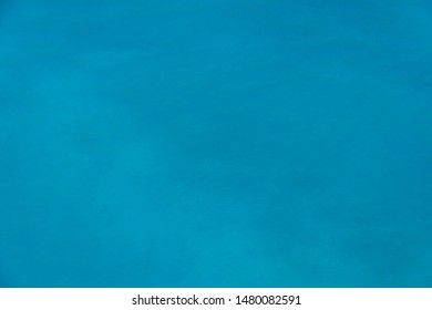 Sea surface. Blue background. Azure sea. Azure and turquoise backgrond. Marine waves.