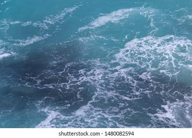 Sea surface. Blue background. Azure sea. Azure backgrond. Turquoise ocean . Marine waves.
